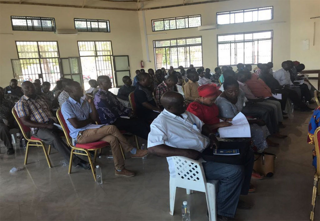 Participants listen to the data roadmap presentation at the District Action Planning Event in Kyela, 3rd Nov. 2018.