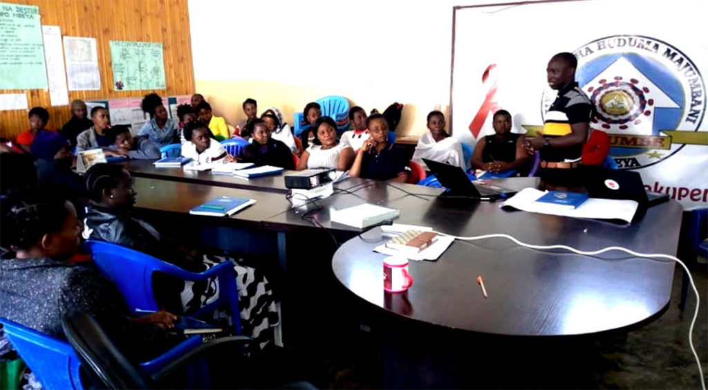 A workshop with KIHUMBE staff and peer educators about ways to use hotspot maps for more effective community outreach.